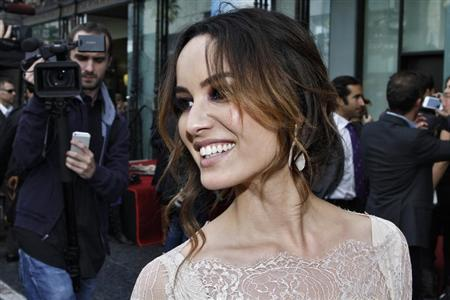 Actress Berenice Marlohe reacts during a ceremony honoring actor Javier Bardem with a star on the Hollywood Walk of Fame in Hollywood, California, November 8, 2012. REUTERS/Jonathan Alcorn
