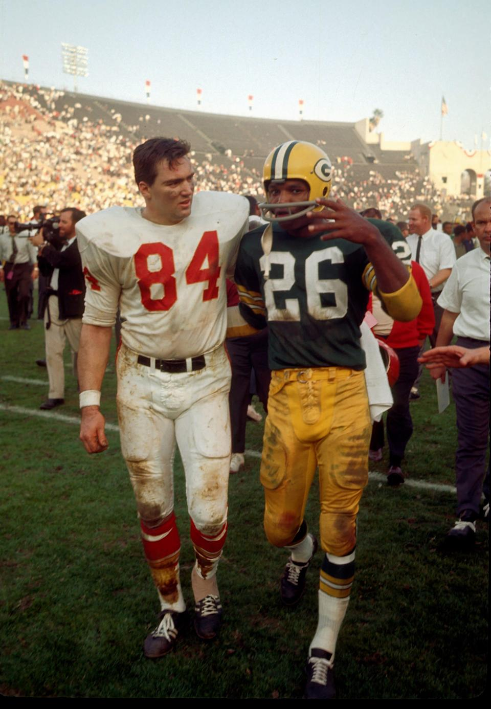 Jan. 15, 1967 in Los Angeles: Kansas City Chiefs tight end Fred Arbanas (84) and Green Bay Packers defensive back Herb Adderley (26) leave the field after the Packers defeated the Chiefs 35-10 in Super Bowl I at the Los Angeles Coliseum.