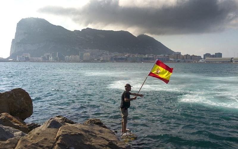 A fisherman flies the Spanish flag during a protest in the Bay of Gibraltar - MARCOS MORENO/AFP/Getty Images