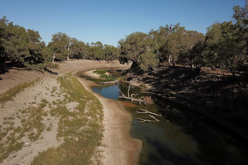 Diminishing water levels on the Darling River are seen below weir 32 near Menindee.