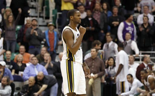 Utah Jazz forward C.J. Miles (34) reacts after time runs out in the second half of an NBA preseason basketball game against the Portland Trail Blazers Wednesday, Dec. 21, 2011, in Salt Lake City. Utah won 92-89. (AP Photo/Jim Urquhart)