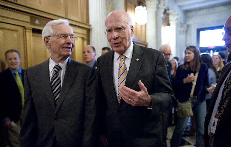 Sen. Patrick Leahy, D-Vt., president pro tempore of the Senate, right, and Sen. Thad Cochran, R-Miss., left, walk to the floor of the Senate during a vote on legislation to collect sales tax on Internet purchases, on Capitol Hill in Washington, Monday, May 6, 2013. (AP Photo/J. Scott Applewhite)