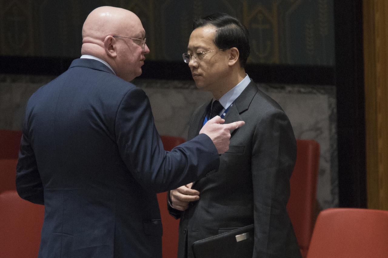 Russian Ambassador to the United Nations Vassily Nebenzia, left, speaks to Chinese Ambassador to the United Nations Ma Zhaoxu before a Security Council meeting on the situation in Syria, Friday, Feb. 23, 2018, at United Nations headquarters. (AP Photo/Mary Altaffer)