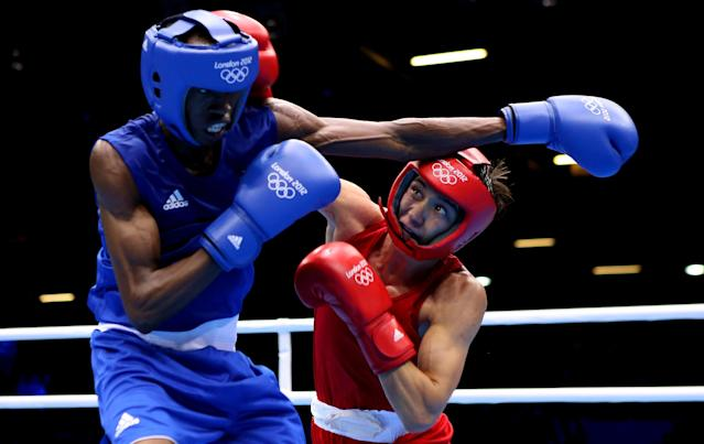 LONDON, ENGLAND - JULY 30: Salomo Ntuve (L) in action with Ilyas Suleimenov of Kazakhstan during their Men's Fly (52kg) Boxing on Day 3 of the London 2012 Olympic Games at ExCeL on July 30, 2012 in London, England. (Photo by Scott Heavey/Getty Images)