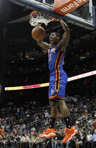 New York Knicks guard Iman Shumpert (21) scores against the Atlanta Hawksin the first half of an NBA basketball game on Friday, March 30, 2012 in Atlanta. (AP Photo/John Bazemore)