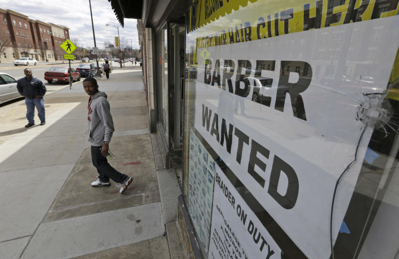 FILE - This  Friday, March 29, 2013 file photo shows a help wanted sign at a barber shop in Richmond, Va. U.S. employers added just 88,000 jobs in March, the fewest in nine months and a sharp retreat after a period of strong hiring. Many discouraged Americans are giving up the job hunt for school, retirement and disability. (AP Photo/Steve Helber, File)