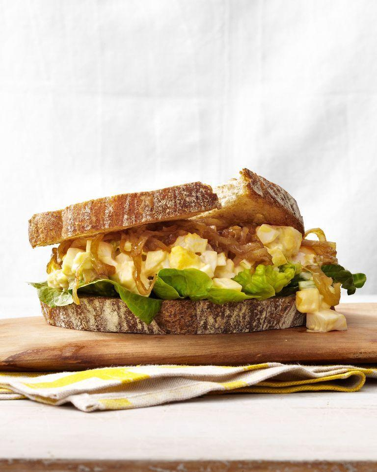 """<p>An upgraded version of a classic, the caramelized onions add some sweet notes to this salty dish. </p><p><strong><em>Get the recipe at <a href=""""https://www.countryliving.com/food-drinks/recipes/a4794/egg-salad-caramelized-onion-sandwiches-recipe-clv0214/"""" rel=""""nofollow noopener"""" target=""""_blank"""" data-ylk=""""slk:Country Living"""" class=""""link rapid-noclick-resp"""">Country Living</a>. </em></strong></p>"""