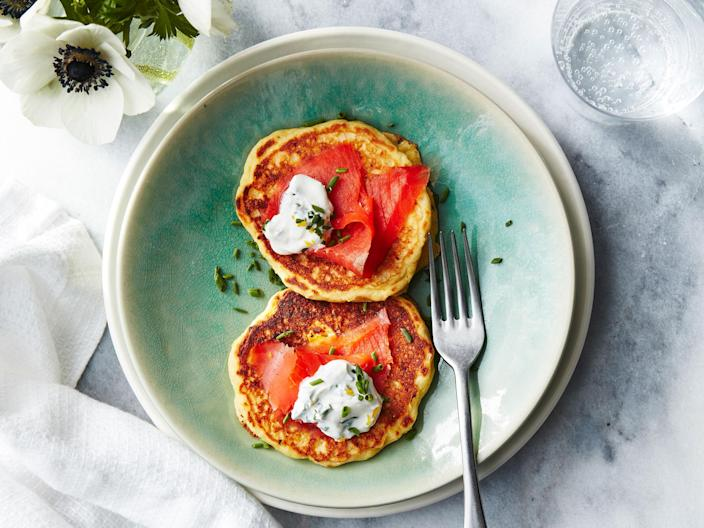 """<p>These savory pancakes are dressed perfectly with fresh lemon-chive cream and smoked salmon. Breakfast time, or anytime, these are a must try.</p> <p> <a rel=""""nofollow noopener"""" href=""""http://www.myrecipes.com/recipe/corn-pancakes"""" target=""""_blank"""" data-ylk=""""slk:View Recipe: Corn Pancakes with Smoked Salmon and Lemon-Chive Cream"""" class=""""link rapid-noclick-resp"""">View Recipe: Corn Pancakes with Smoked Salmon and Lemon-Chive Cream</a></p>"""