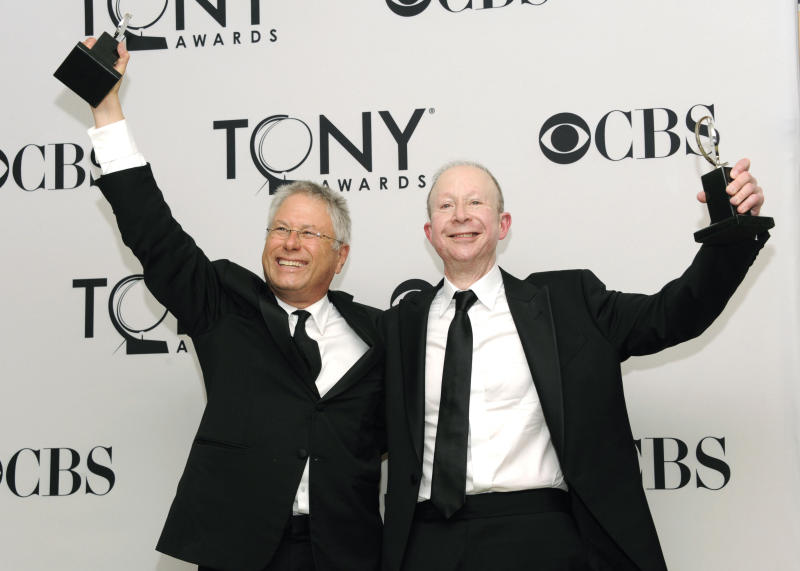 """FILE - This June 10, 2012 file photo shows Composers Alan Menken, left, and Jeff Feldman in the press room at the 66th Annual Tony Awards in New York. Menken and Feldman are nominated for a Grammy Award for best theater album for the Broadway musical """"Newsies."""" (Photo by Evan Agostini/Invision/AP, file)"""