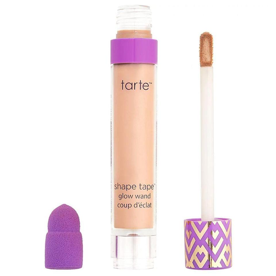 """<p><strong>Tarte</strong></p><p>ulta.com</p><p><a href=""""https://go.redirectingat.com?id=74968X1596630&url=https%3A%2F%2Fwww.ulta.com%2Fshape-tape-glow-wand%3FproductId%3Dpimprod2012611&sref=https%3A%2F%2Fwww.bestproducts.com%2Fbeauty%2Fg33899927%2Fulta-21-days-of-beauty-sale-2020%2F"""" rel=""""nofollow noopener"""" target=""""_blank"""" data-ylk=""""slk:Shop Now"""" class=""""link rapid-noclick-resp"""">Shop Now</a></p><p><del>$25</del><br><strong>$12.50</strong></p><p>If you're obsessed with the original Tarte Shape Tape concealer, then upgrade to the glow wand and prepare to be amazed. It's a vegan liquid brightener that's perfect for lightening up any under-eye circles, creating a lifted and youthful look in just a few swipes.</p>"""