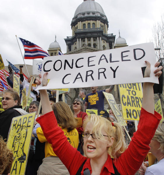 FILE - In this March 7, 2012 file photo, gun owners and supporters participate in an Illinois Gun Owners Lobby Day rally at the Illinois State Capitol in Springfield. In a big victory for gun rights advocates, a federal appeals court on Tuesday, Dec. 11, 2012, struck down a ban on carrying concealed weapons in Illinois _ the only remaining state where carrying concealed weapons is entirely illegal. (AP Photo/Seth Perlman, File)