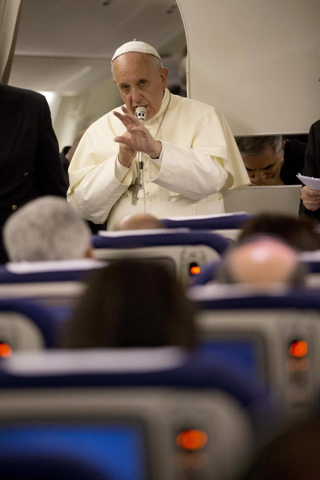 Pope Francis talks to journalists during a press conference he held aboard the papal flight on his way back to Rome at the end of a three day trip to the Midle East, Monday, May 26, 2014 (AP Photo/Andrew Medichini, Pool)
