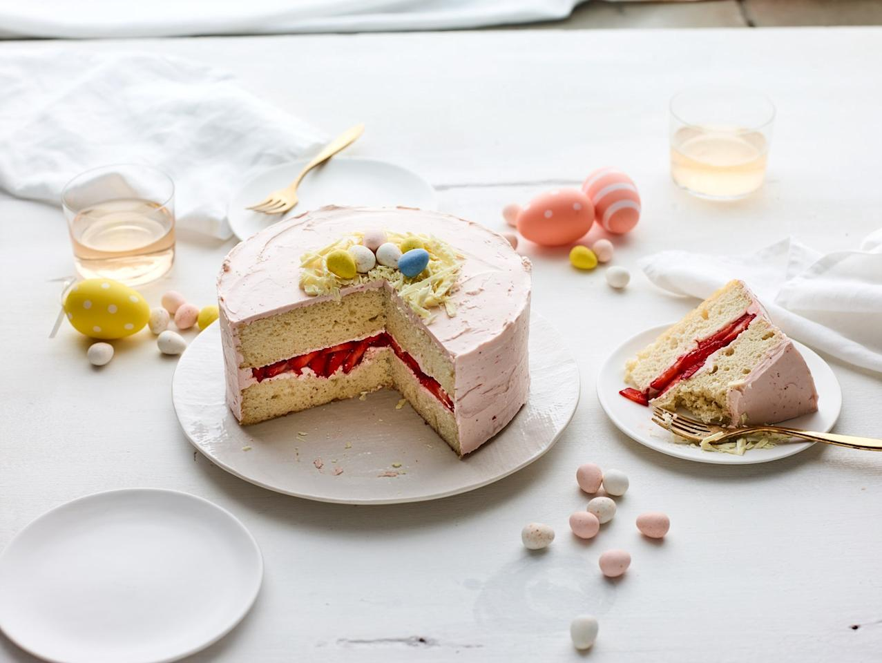 "White chocolate shavings form a ""nest"" for chocolate eggs on this pretty pink cake. Malted milk powder gives both the cake and the frosting a toasty flavor and creamy richness. <a href=""https://www.epicurious.com/recipes/food/views/easter-egg-cake-with-strawberry-frosting?mbid=synd_yahoo_rss"">See recipe.</a>"