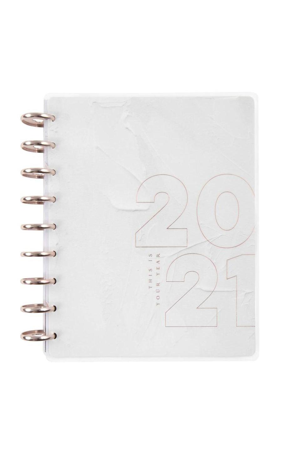 """<p><strong>The Happy Planner</strong></p><p><strong>$32.99</strong></p><p><a href=""""https://go.redirectingat.com?id=74968X1596630&url=https%3A%2F%2Fthehappyplanner.com%2Fcollections%2F2021-planners%2Fproducts%2Fdeluxe-classic-vertical-weekly-planner-minimalist-your-year-12-months&sref=https%3A%2F%2Fwww.marieclaire.com%2Fhome%2Fg33996666%2Fbest-planners-agendas-2021%2F"""" rel=""""nofollow noopener"""" target=""""_blank"""" data-ylk=""""slk:SHOP IT"""" class=""""link rapid-noclick-resp"""">SHOP IT</a></p><p>Perfect for teachers, students, and busy executives alike, this minimalist Happy Planner is complete with goal-setting, action steps, and reflection, is a go-to for anybody who's hoping to start off the year with positive vibes. </p>"""