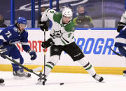Dallas Stars defenseman Miro Heiskanen (4) handles the puck during the first period of the team's NHL hockey game against the Tampa Bay Lightning on Friday, May 7, 2021, in Tampa, Fla. (AP Photo/Jason Behnken)
