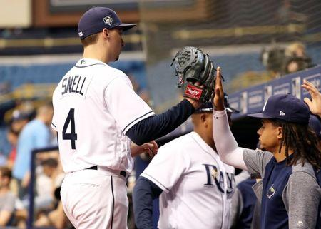May 24, 2018; St. Petersburg, FL, USA; Tampa Bay Rays starting pitcher Blake Snell (4) is congratulated by pitcher Chris Archer (22) and teammates at the end of the top of the fifth inning against the Boston Red Sox at Tropicana Field. Mandatory Credit: Kim Klement-USA TODAY Sports