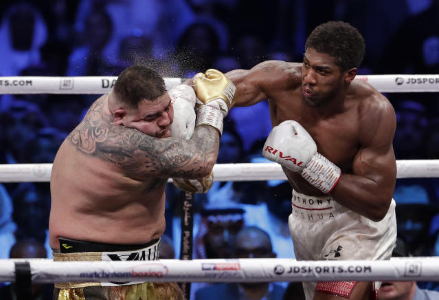 Andy Ruiz Jr. takes a right cross to the face during his fight against Anthony Joshua in their heavyweight championship contest at the Diriyah Arena, Riyadh, Saudi Arabia early Sunday Dec. 8, 2019. (AP Photo/Hassan Ammar)