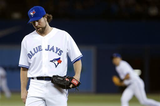 Toronto Blue Jays pitcher R.A. Dickey reacts during the fifth inning of a baseball game against the Chicago White Sox in Toronto on Thursday, April 18, 2013. (AP Photo/The Canadian Press, Chris Young)