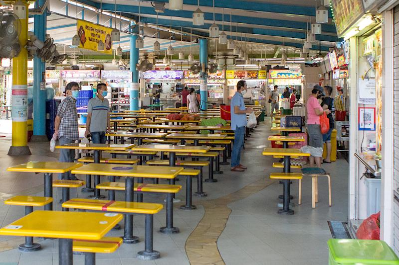 People seen queueing for food at the Zion Riverside Food Centre on 5 May 2020. (PHOTO: Dhany Osman / Yahoo News Singapore)