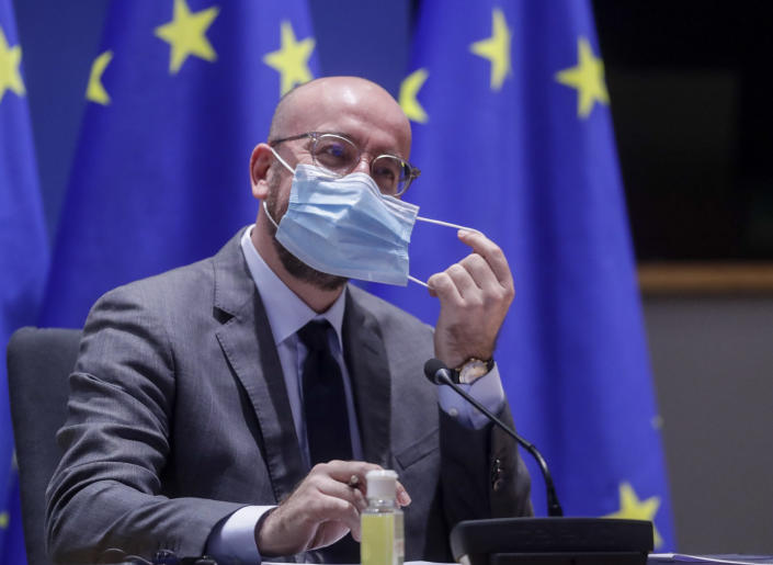 European Council President Charles Michel removes his face mask as he chairs a EU summit video conference at the European Council headquarters in Brussels, Thursday, Jan. 21, 2021. Worried that the new coronavirus variants could result in another surge of deaths across the European Union and push hospitals to the verge of collapse, EU leaders will assess in a video summit Thursday such measures as further border restrictions, better tracking of mutations and improving coordination of lockdowns. (Olivier Hoslet, Pool Photo via AP)