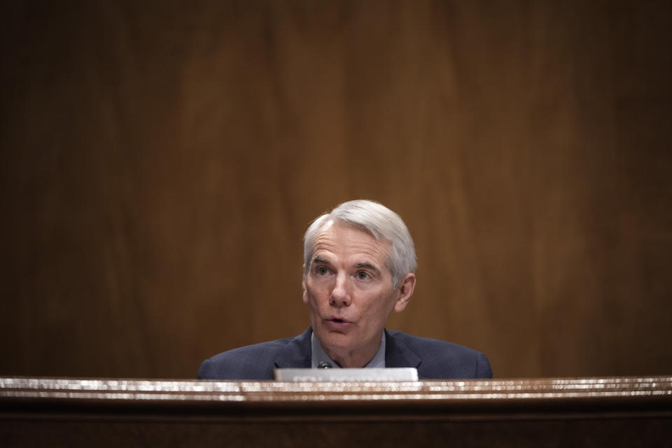Ranking member Sen. Rob Portman, R-Ohio, questions Deanne Criswell, President Joe Biden's choice to be FEMA administrator, as she testifies at her confirmation hearing before the Senate Homeland Security Committee, on Capitol Hill in Washington, Thursday, March 25, 2021. (Drew Angerer/Pool via AP)
