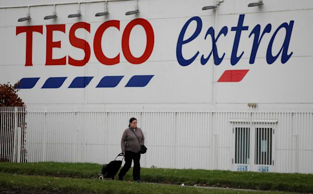 A woman walks past a Tesco extra superstore near Manchester, UK. Photo: Phil Noble/Reuters