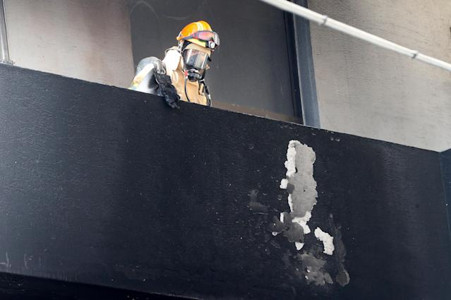 <p>A firefighter looks around at a burnt hospital in Miryang, South Korea, Jan. 26, 2018. (Photo: Yonhap via Reuters) </p>