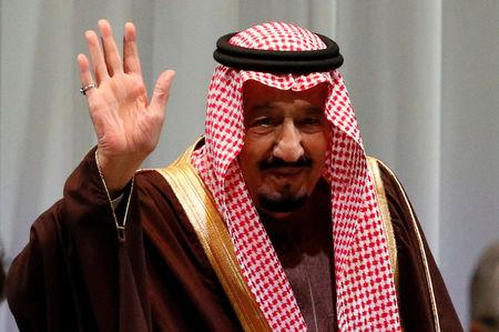 Saudi King Salman bin Abdulaziz Al-Saud waves as he attends Saudi-Japan Vision 2030 Business Forum in Tokyo