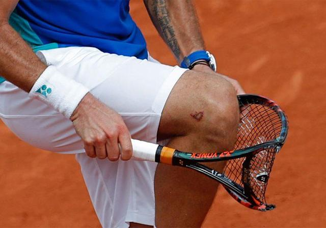 Stan Wawrinka took out some of his frustration Sunday on his racket. (AP)