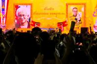 A still image from a video shows images of Somsak and Pavin at a demonstration in Bangkok