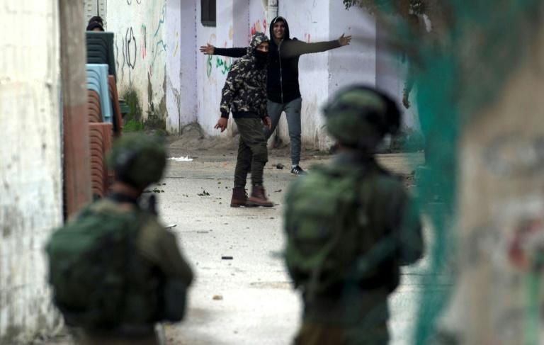 Israeli forces clash with Palestinian youths during a raid on the city of Jenin in the north of the occupied West Bank, on January 18, 2018