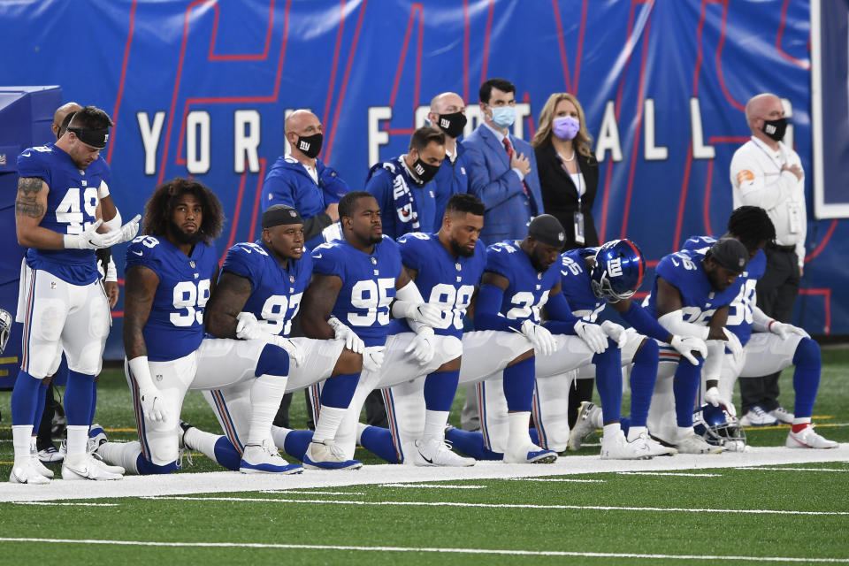 Members of the New York Giants kneel before a game. (Photo by Sarah Stier/Getty Images)