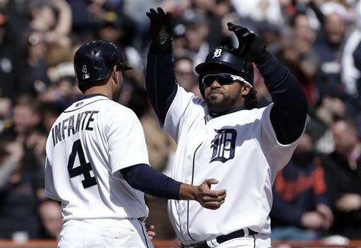 Detroit Tigers' Prince Fielder, right, is congratulated by Omar Infante after hitting a 3-run home run against the New York Yankees in the fifth inning of a baseball game in Detroit, Friday April 5, 2013. (AP Photo/Paul Sancya)