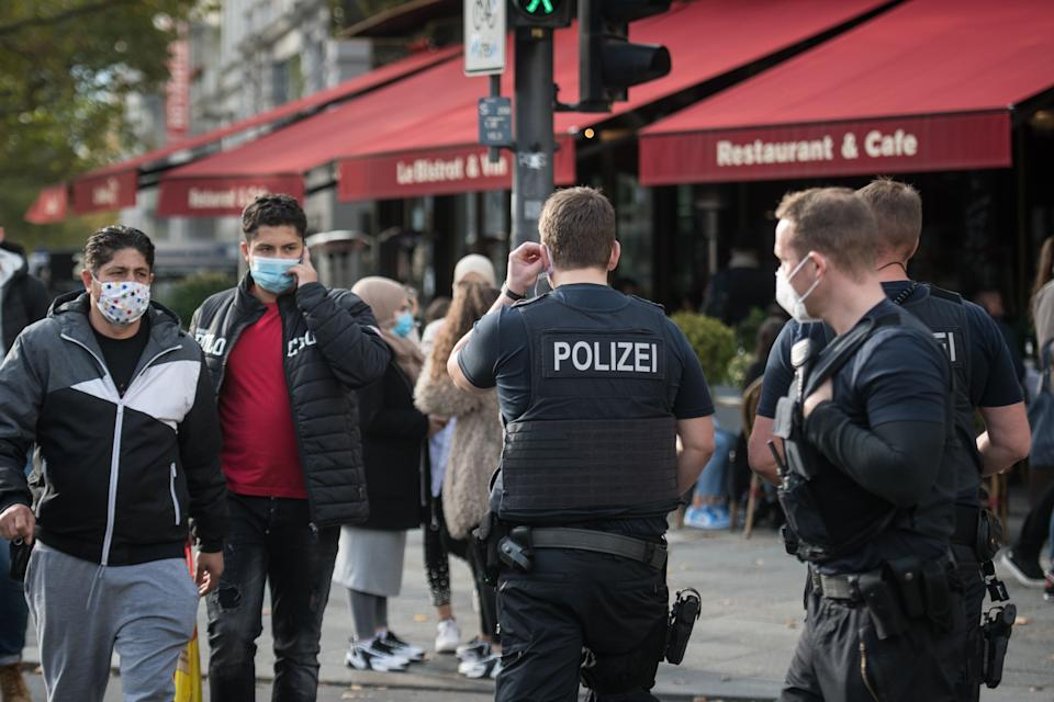 Police officers of the Federal Police patrol at Kurfuerstendamm (Ku'damm), a popular shopping street on October 24, 2020 in Berlin. - Measures to contain the coronavirus Covid-19 pandemic have been tightened and city authorities decided the requirement that people wear masks outside in busy commercial areas. (Photo by STEFANIE LOOS / AFP) (Photo by STEFANIE LOOS/AFP via Getty Images)