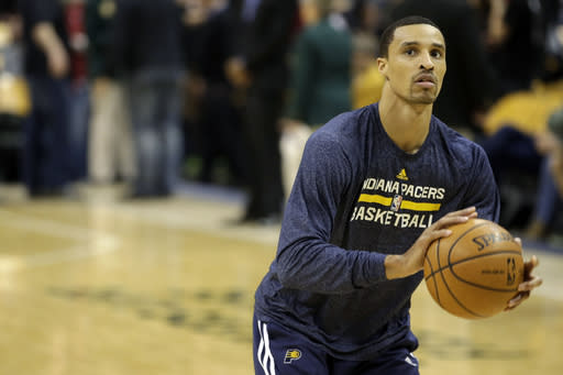 Indiana Pacers guard George Hill warms up before the start of an NBA basketball game against the Miami Heat in Indianapolis, Wednesday, March 26, 2014. (AP Photo/AJ Mast)