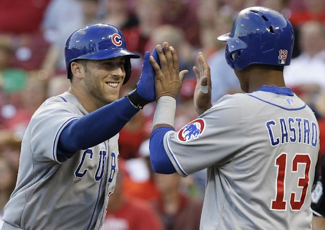 Chicago Cubs' Mike Olt is congratulated by Starlin Castro (13) after Olt hit a solo home run off Cincinnati Reds starting pitcher David Holmberg in the third inning of a baseball game, Tuesday, July 8, 2014, in Cincinnati. (AP Photo/Al Behrman)