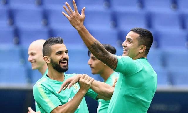 Aziz Behich and Tim Cahill train ahead of the Denmark match.