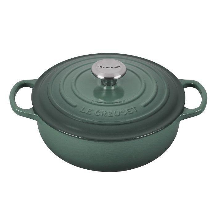 """<p><strong>Le Creuset</strong></p><p>williams-sonoma.com</p><p><strong>$179.95</strong></p><p><a href=""""https://go.redirectingat.com?id=74968X1596630&url=https%3A%2F%2Fwww.williams-sonoma.com%2Fproducts%2Fle-creuset-signature-cast-iron-3-5qt-essential-oven&sref=https%3A%2F%2Fwww.veranda.com%2Fshopping%2Fg36719869%2Fgreen-kitchen-essentials%2F"""" rel=""""nofollow noopener"""" target=""""_blank"""" data-ylk=""""slk:Shop Now"""" class=""""link rapid-noclick-resp"""">Shop Now</a></p><p>The classic cast iron Dutch oven by Le Creuset gets a lush upgrade with the new Artichaut colorway, a moody sea green shade. </p>"""