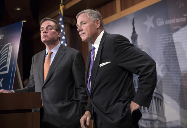 Senate Select Committee on Intelligence Chairman Richard Burr, R-N.C., and Vice Chairman Mark Warner, D-Va., left, update reporters on the status of their inquiry into Russian interference in the 2016 U.S. election, at the Capitol Oct. 4. Burr says the committee has interviewed more than 100 witnesses as part of its investigation and that more work still needs to be done. (Photo: J. Scott Applewhite/AP)