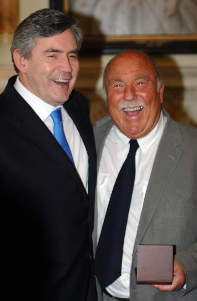 Jimmy Greaves (right) smiles after collecting his World Cup winners medal