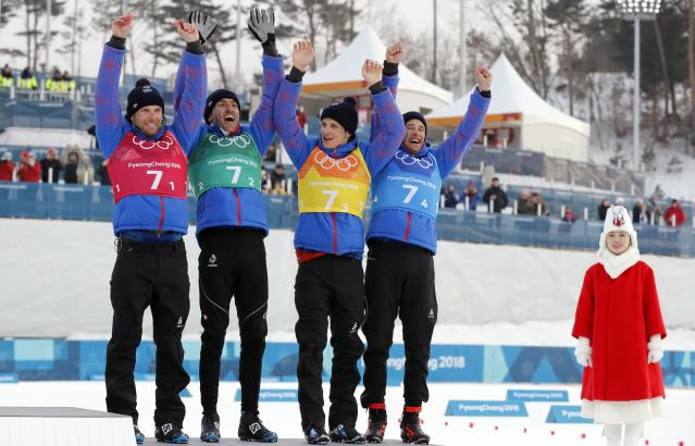Cross-Country Skiing - Pyeongchang 2018 Winter Olympics - Men's 4x10 km Relay - Alpensia Cross-Country Skiing Centre - Pyeongchang, South Korea - February 18, 2018 - Bronze medallists Jean Marc Gaillard, Maurice Manificat, Clement Parisse and Adrien Backsheider of France celebrate on the podium. REUTERS/Jorge Silva