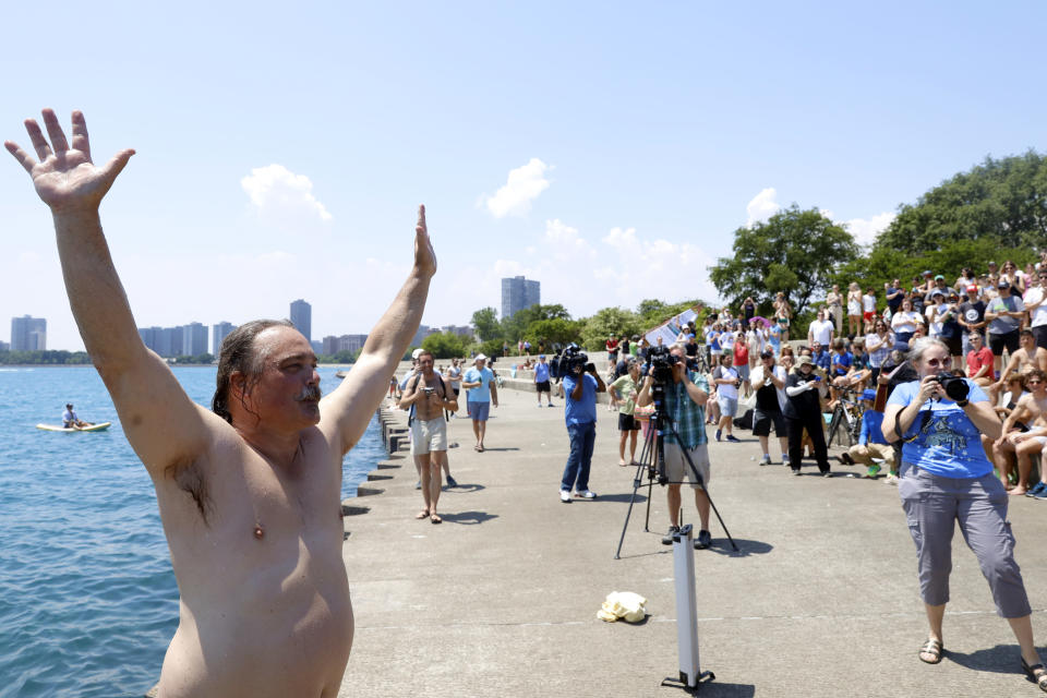 """Dan O'Conor, the """"Great Lake Jumper,"""" reacts after making his 365th leap into Lake Michigan, Saturday, June 12, 2021, in Chicago's Montrose Point. (AP Photo/Shafkat Anowar)"""