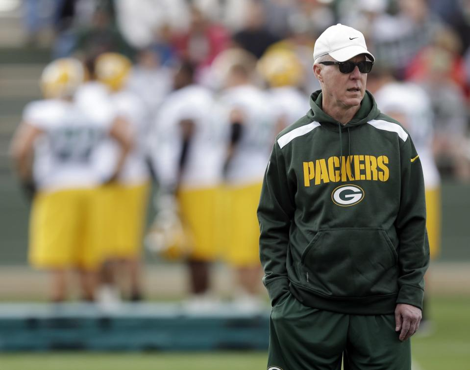 FILE - In this July 27, 2013, file photo, Green Bay Packers general manager Ted Thompson watches during NFL football training camp in Green Bay, Wis. Thompson, whose 13-year run as Green Bay Packers general manager included their 2010 Super Bowl championship season, died Wednesday, Jan 20, the team announced Thursday, Jan. 21, 2021. He was 68. Thompson was Packers general manager from 2005-17 and drafted many notable players on the current roster, including two-time MVP quarterback Aaron Rodgers. (AP Photo/Morry Gash, File)
