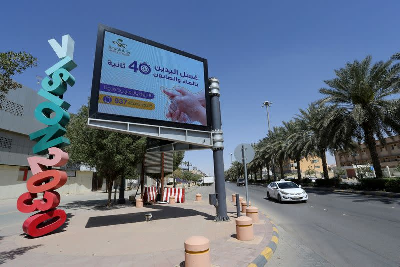 Banner with an instruction on personnel hygiene is seen at the street, following the outbreak of coronavirus, in Riyadh