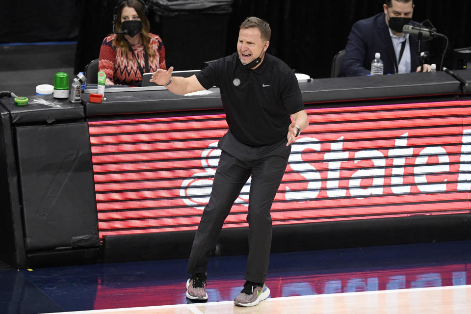 Washington Wizards coach Scott Brooks reacts during the first half of the team's NBA basketball Eastern Conference play-in game against the Indiana Pacers, Thursday, May 20, 2021, in Washington. (AP Photo/Nick Wass)