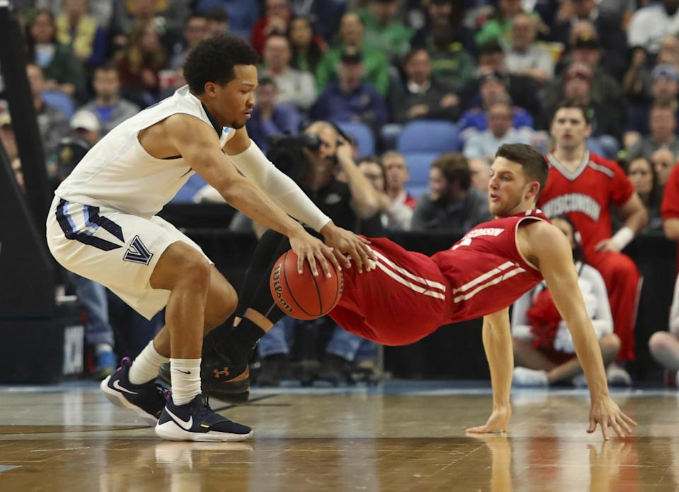 <p>Villanova guard Jalen Brunson (1) is defended by Wisconsin guard Zak Showalter, right, during the first half of a second-round men's college basketball game in the NCAA Tournament, Saturday, March 18, 2017, in Buffalo, N.Y. (AP Photo/Bill Wippert) </p>