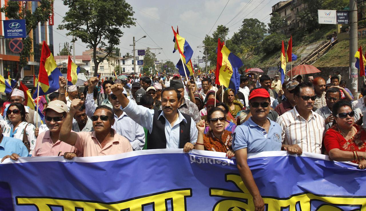 Supporters of pro-monarchy Rastriya Prajatantra Party take out a rally demanding that Nepal be declared a Hindu nation in Katmandu, Nepal, Monday, May 28, 2012. Nepal sank into political turmoil Monday after lawmakers failed to agree on a new constitution, leaving the country with no legal government. (AP Photo/Binod Joshi)