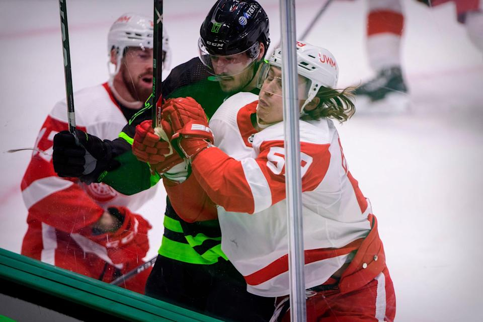 Detroit Red Wings left wing Tyler Bertuzzi (59) checks Dallas Stars right wing Nick Caamano (17) during the first period Jan. 28, 2021, at the American Airlines Center.