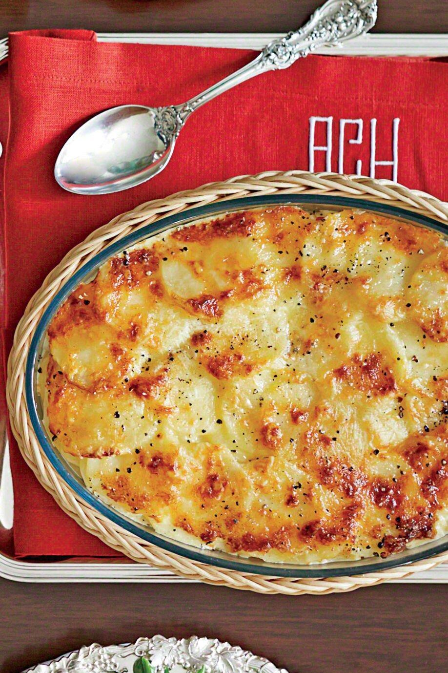 """<p><strong>Recipe:</strong> <strong><a href=""""https://www.southernliving.com/syndication/potatoes-patio"""" rel=""""nofollow noopener"""" target=""""_blank"""" data-ylk=""""slk:Potatoes Patio"""" class=""""link rapid-noclick-resp"""">Potatoes Patio</a></strong></p> <p>A mixture of Gruyère and Parmesan cheese makes this luxurious baked dish all the more delicious.</p>"""