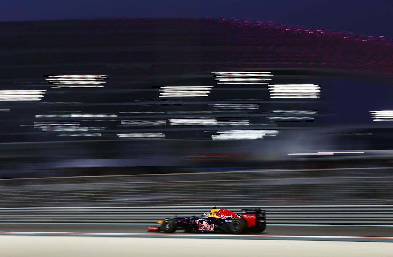 ABU DHABI, UNITED ARAB EMIRATES - NOVEMBER 04:  Sebastian Vettel of Germany and Red Bull Racing drives during the Abu Dhabi Formula One Grand Prix at the Yas Marina Circuit on November 4, 2012 in Abu Dhabi, United Arab Emirates.  (Photo by Paul Gilham/Getty Images)